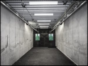 The shooting range at the Survival Condo Project. Hall said that the hardest part of the project was sustaining life underground. He studied how to avoid depression (add more lights) and prevent cliques (rotate chores). Photograph by Dan Winters for The New Yorker
